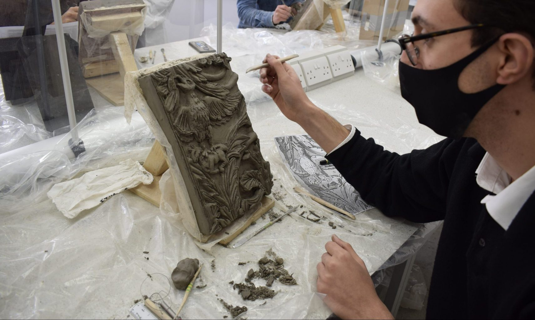 How can an Art School function during a global pandemic? - BA Conservation student in bas relief workshop