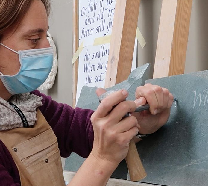 How can an Art School function during a global pandemic? - Stone Carving student carving lettering onto slate
