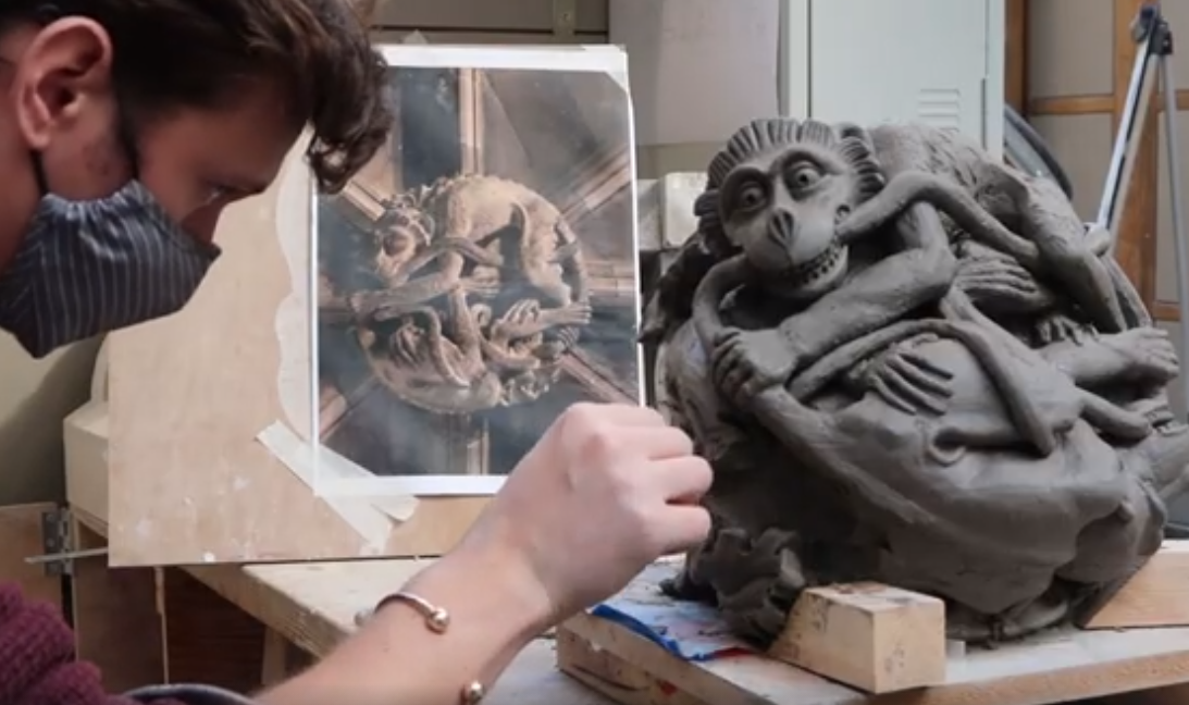 How can an Art School function during a global pandemic? - Stone Carving student working on a clay model